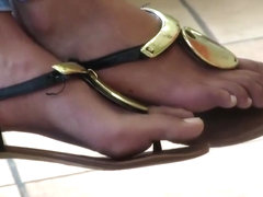 Beautiful girl thong sandals faceshot at beginning