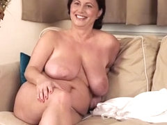 Mellow busty old female haning an incredible masturbation