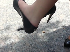 Blonde office lady dangling shoeplay her pumps