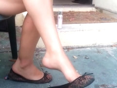 Ghetto MILF with sexy legs dangling flats