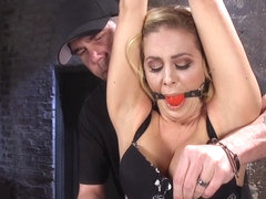 Stunning blonde Milf gagged in bdsm