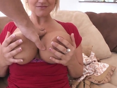 Horny blonde milf Julie Castle takes off her clothes to show her grandiose charms
