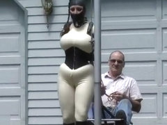 rubber doll jewell in TIGHT corset and white catsuit