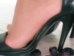 lady in pvc crushing fruit