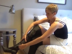Cute blond tries on different pairs of boots