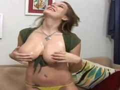 Cassandra Calogera plays with gigantic oiled tits