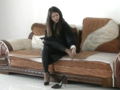 Chinese girl sprains foot in high heel and nylon