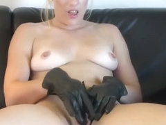 Kinky blonde in boots panties masturbates with naughty soft leather gloves