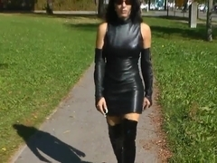 Lady with long black hair and hot leather outfit
