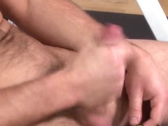Muscly gay pornstar cums tugging