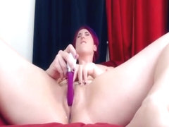 Naughty redhead sex bomb plays with a big vibrating toy