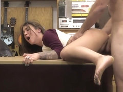 Excellent juvenile woman is having sex in shop with man