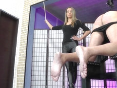 Sadistic young blonde domina punishes her slave hard on the caning bench