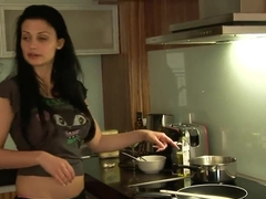 Aletta Ocean cooking and demonstrating her boobs