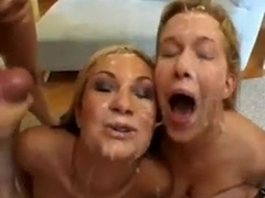 Two girls getting covered in cum 2