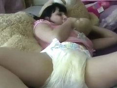 Lexi Cuddles Mr.Bear With An Enormous Enema Mess In Her Diaper!