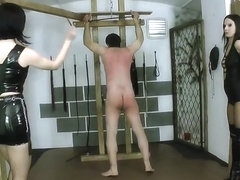 Two junior ladies whipping male slave 02