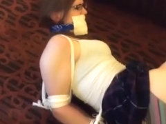 Bondage girl struggles from couch to floor
