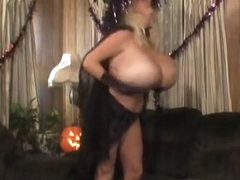 Halloween MILF with very huge silicone tits