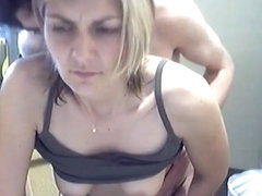 Blonde wife takes her husband's cock doggy style on webcam