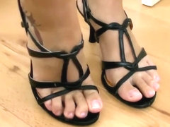 Marinka spits inside her strappy sandals and wears them