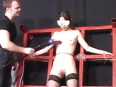 Bound Asian chick endures kinky whipping