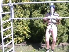 naked slave BDSM CBT outdoor in slaveharness
