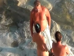 Nudist couple handjob and pussy eating