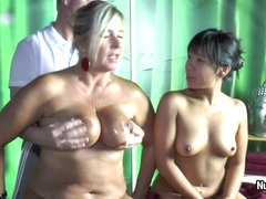 Blonde MILF Nude Chrissy and Asian brunette are doing handjob for old man