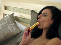 Dark haired milf Gabi de Castello plays with her pink